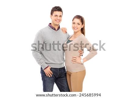 Happy couple posing together isolated on white background  - stock photo
