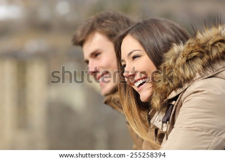 Happy couple profile looking forward in winter holiday - stock photo