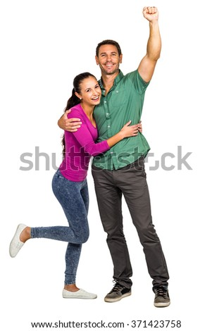 Happy couple rejoicing on white screen