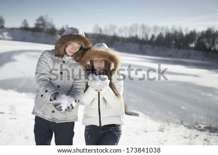 Happy couple relaxing and having fun in the park - stock photo