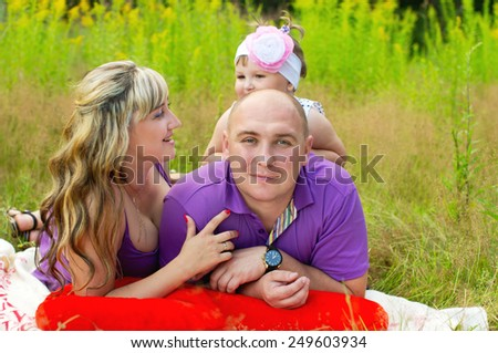 Happy couple relaxing on nature - stock photo