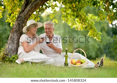 happy couple relaxing together and drinking wine together - stock photo