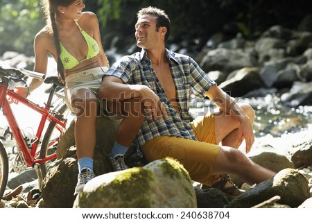 Happy Couple Resting at Brook - stock photo