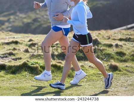Happy couple running on the beach - stock photo