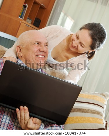 happy couple shopping at home via  Internet - stock photo