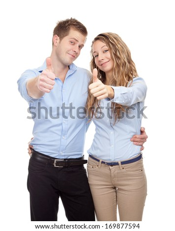 Happy couple showing thumbs up isolated on white - stock photo