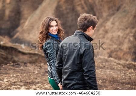 Happy couple smiling outdoors on hiking trip in the mountains