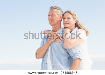 Happy couple spending time together at the beach - stock photo