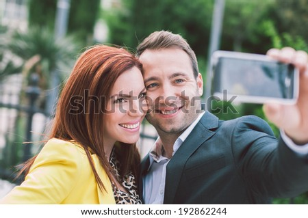 Happy couple taking selfie - stock photo
