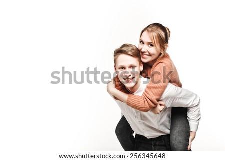 happy couple teenagers in studio - stock photo