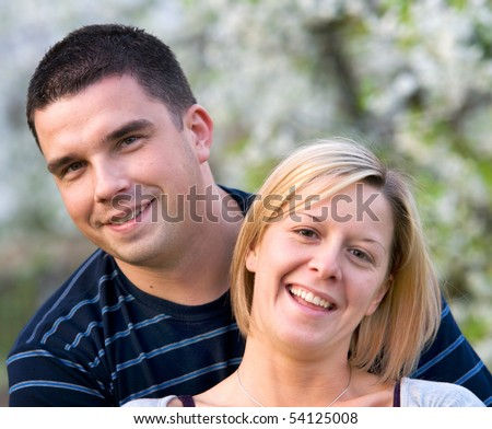 Happy couple together in romantic scenery - stock photo