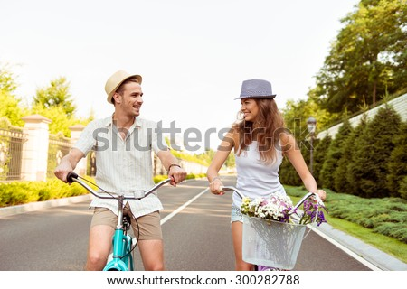 happy couple together to ride a bicycle - stock photo