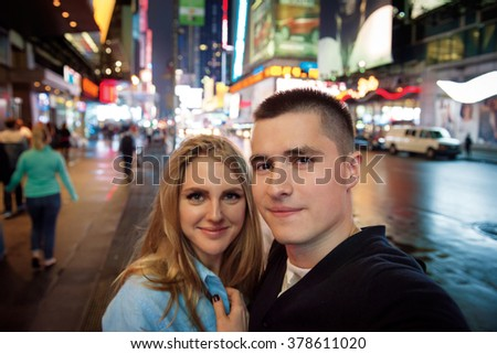 Happy couple traveling in New Your City and taking selfie photo - stock photo
