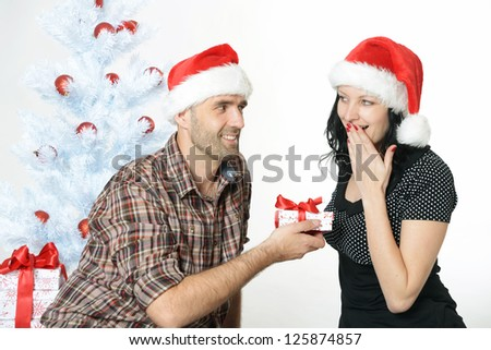 happy couple under the christmas tree