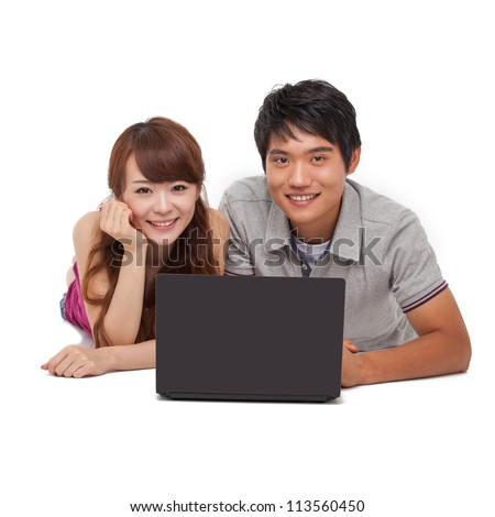 Happy couple using laptop isolated on white background.