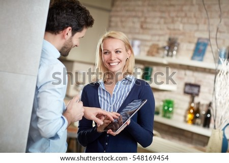 Happy couple using tablet computer.