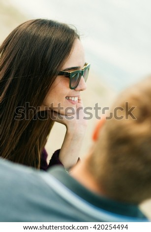 Happy couple. View on a smiling beautiful woman over the man - stock photo