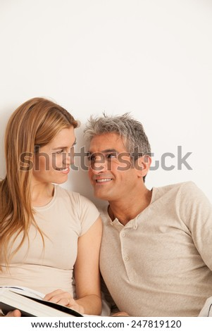 Happy couple viewing a photo album - stock photo