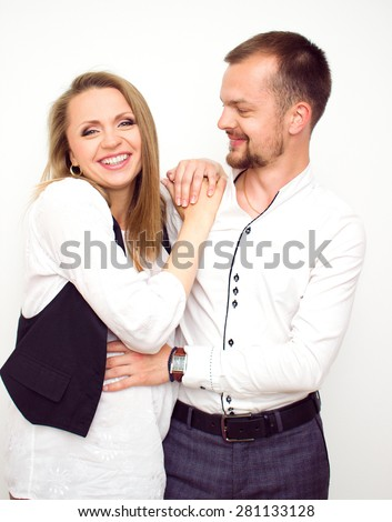 Happy couple waiting for a baby, handsome guy with his beautiful pregnant wife, looking on each other, love concept - stock photo