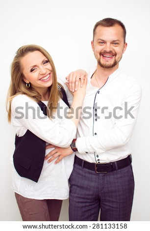 Happy couple waiting for a baby, handsome guy with his beautiful pregnant wife, love concept - stock photo