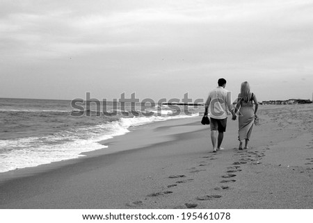 Happy Couple Walking on Beach
