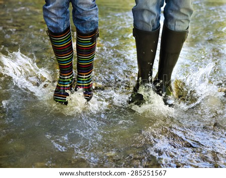 Happy couple wearing colorful rain boots. Happiness and fun concept