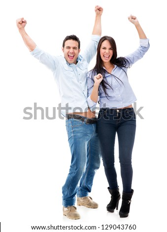 Happy couple with arms up celebrating - isolated over white - stock photo