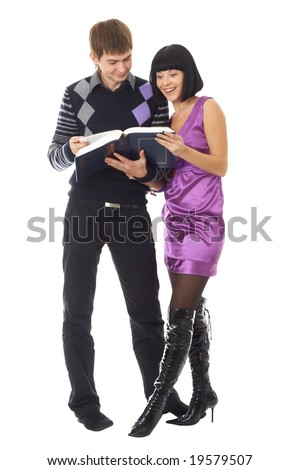 Happy couple with book isolated on white background