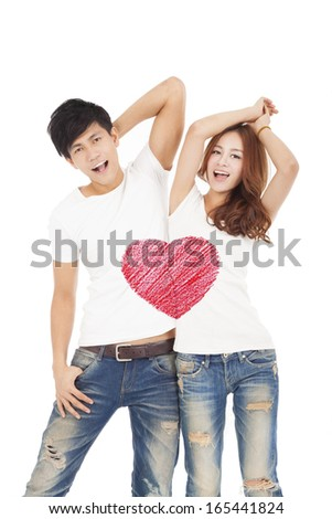 happy couple with love heart symbol design on the whit t shirt - stock photo