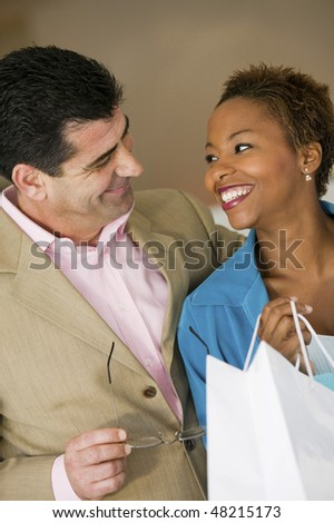 Happy Couple With Shopping Bag - stock photo