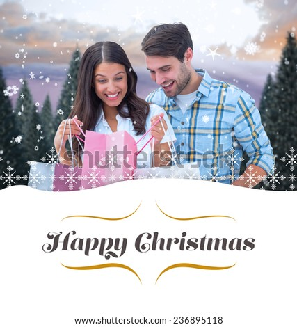 happy couple with shopping bags against border - stock photo