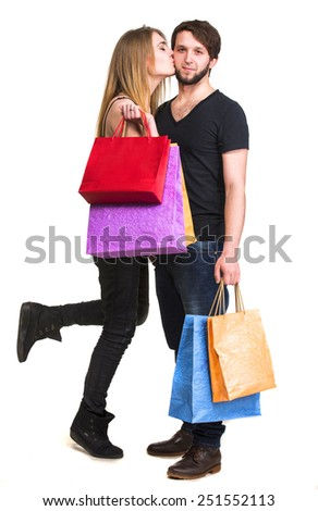 Happy couple with shopping bags on a white background