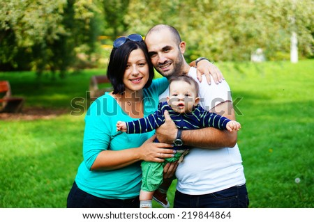 Happy couple with small baby boy - stock photo