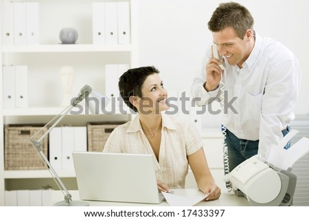 Happy couple working at home office running small business. - stock photo