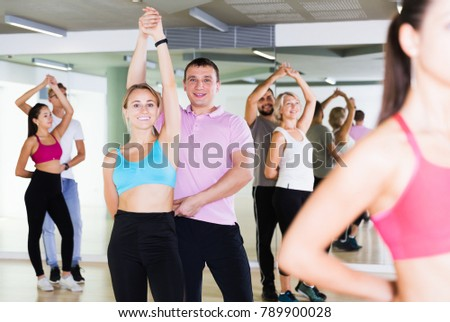 Happy couples enjoying of partner dance and smiling indoor