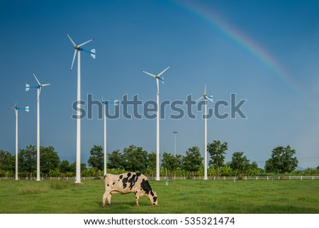 happy cow and rainbow on nice sky