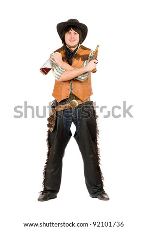 Happy cowboy with a bottle and gun in hands - stock photo