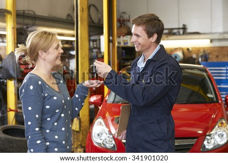 Happy Customer Collecting Car From Garage - stock photo