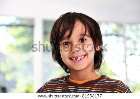 Happy cute boy without front tooth, prepared for the school - stock photo