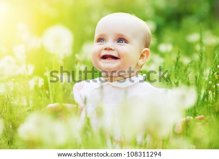 happy cute child on the field - stock photo