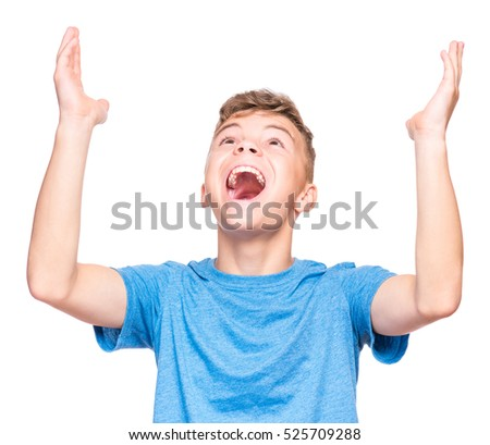 Happy cute child reaching out his palms and catching something. Half-length emotional portrait of caucasian teen boy wearing blue t-shirt, surprised. Funny teenager trying to catch something, isolated