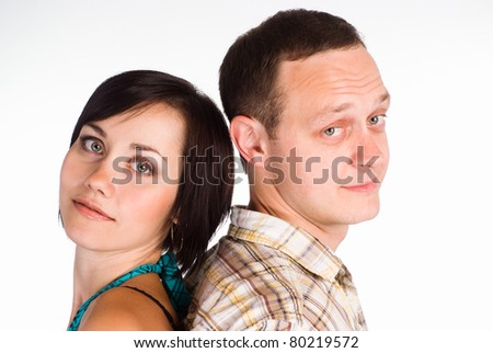 happy cute couple posing on a white