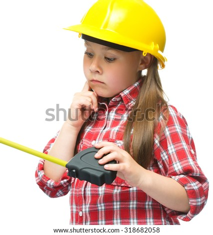 Happy cute girl as a construction worker with tape measure, isolated over white - stock photo