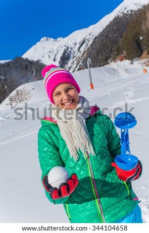 Happy cute girl having fun in the snow - stock photo