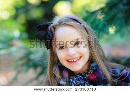 Happy cute girl in autumn fall outdoor