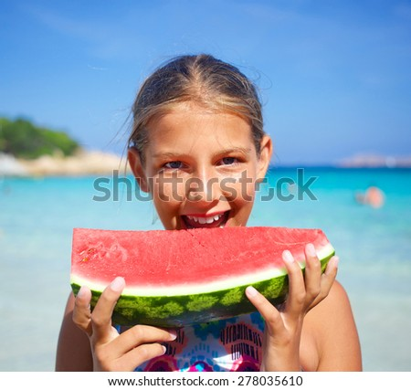 Happy cute girl on the sea with watermelon - stock photo