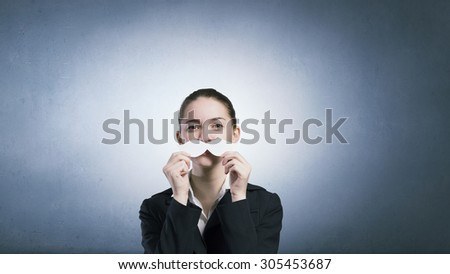 Happy cute girl trying male paper mustache