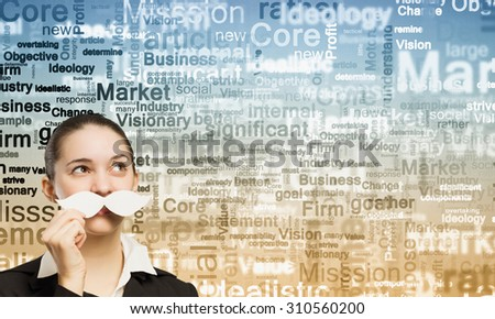 Happy cute girl trying male paper mustache - stock photo