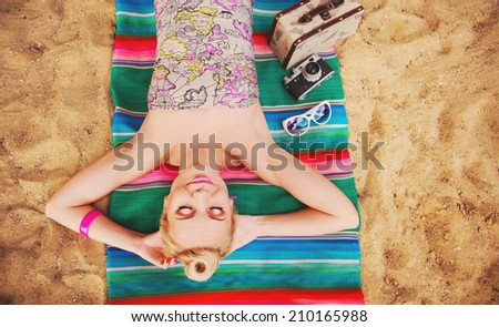 happy cute hot body young woman lying on the beach with colorful details, relax concept  - stock photo