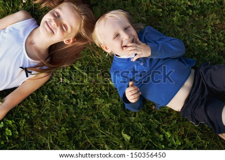 happy cute kids on the grass - stock photo